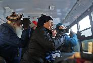 Susan Elliott of Mendota Heights, front, and Sidney Crawford of Ozona, Fla., left, joined other birders in trying to get a glimpse of birds at the Sax-Zim Bog in Meadowlands, Minn.DAVID JOLES