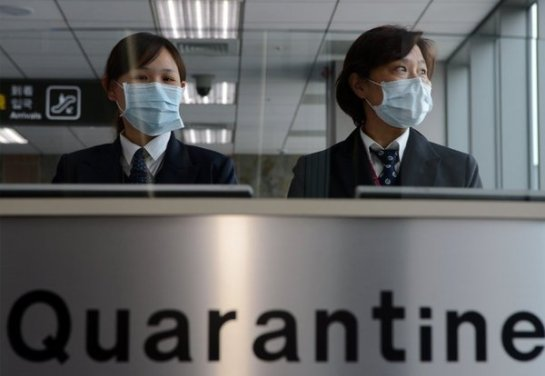 Staff from Taiwan's Center for Disease Control at Sungshan Airport in Taipei. Taiwan has raised its level of alert as new deaths from H7N9 bird flu have been reported. (Sam Yeh / AFP/Getty Images)