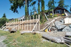 A sea wall under construction at Roberts Bay in Sidney is at the centre of some controversy.