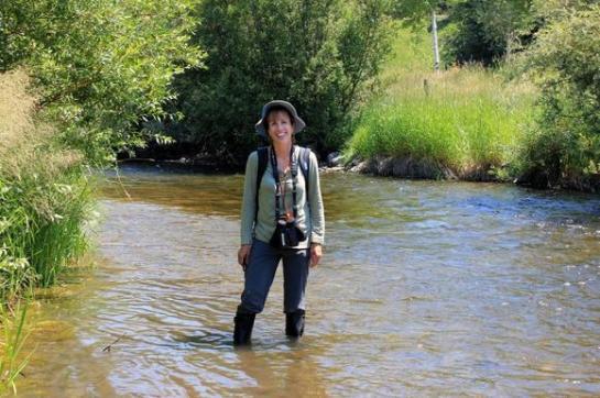 Anne Reinhard wading in Karns Meadow. (Photo By Johnny Jauregui)